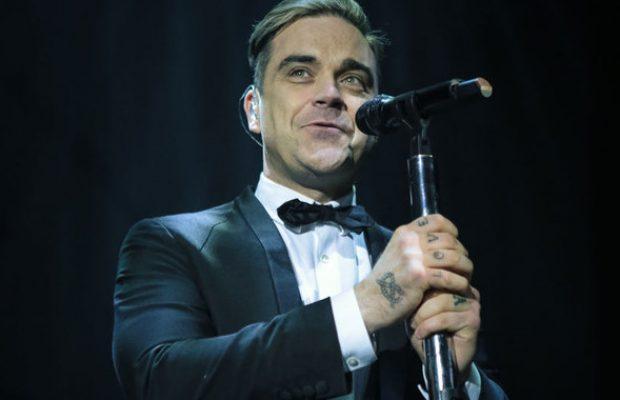 Robbie Williams divulga música nova e anuncia lançamento de àlbum novo
